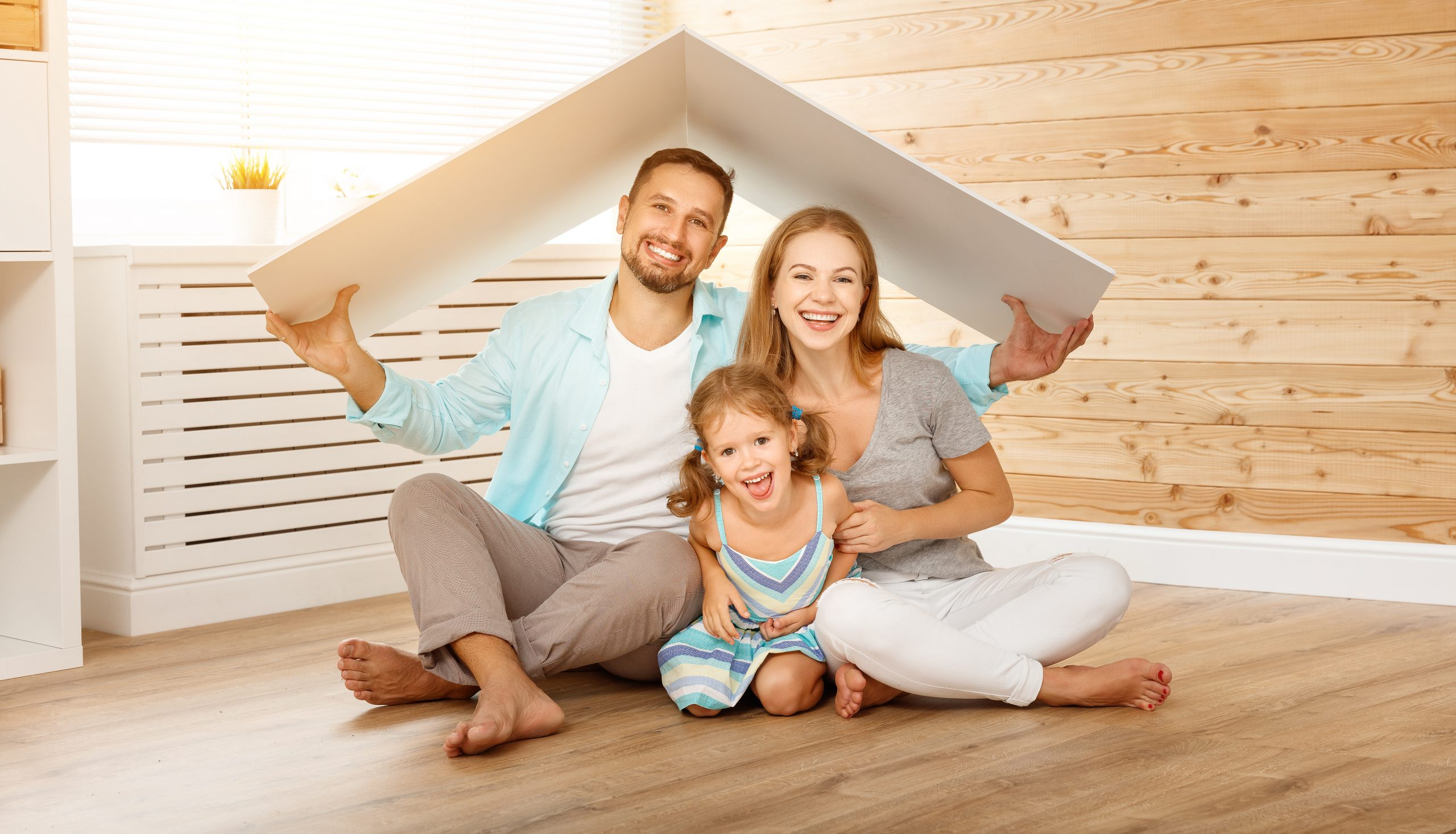 Happy family in a new home. Mom, dad and daughter